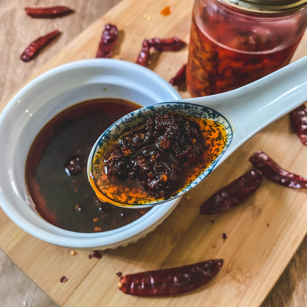 Homemade chili oil on spoon